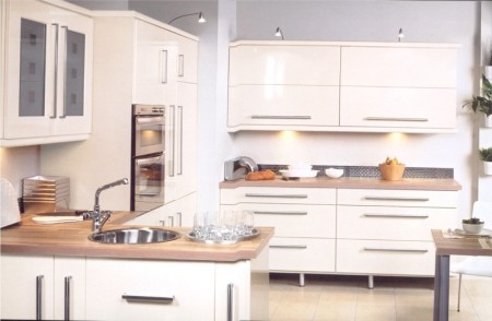 The Keld cream gloss kitchen design is available from Gee's Kitchens, Bedrooms & Flooring of Kildare.